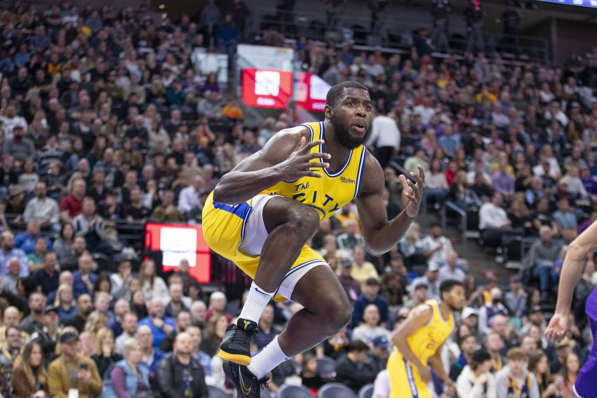 Golden State Warriors forward Eric Paschall reacts to a play during the second quarter against the Utah Jazz at Vivint Smart Home Arena.