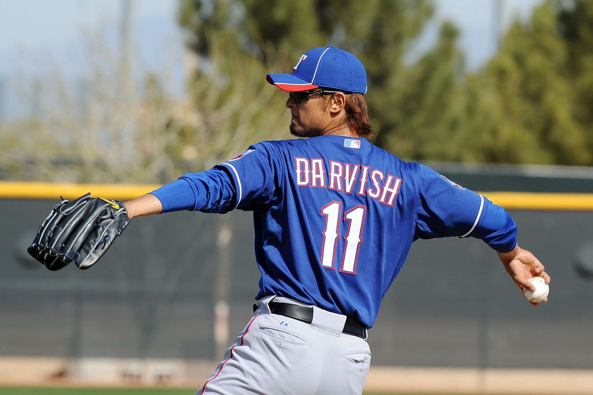 SURPRISE, AZ - FEBRUARY 23:  Yu Darvish #11 of the Texas Rangers throws from the mound during spring workouts at Surprise Stadium on February 23, 2012 in Surprise, Arizona.  (Photo by Norm Hall/Getty Images)