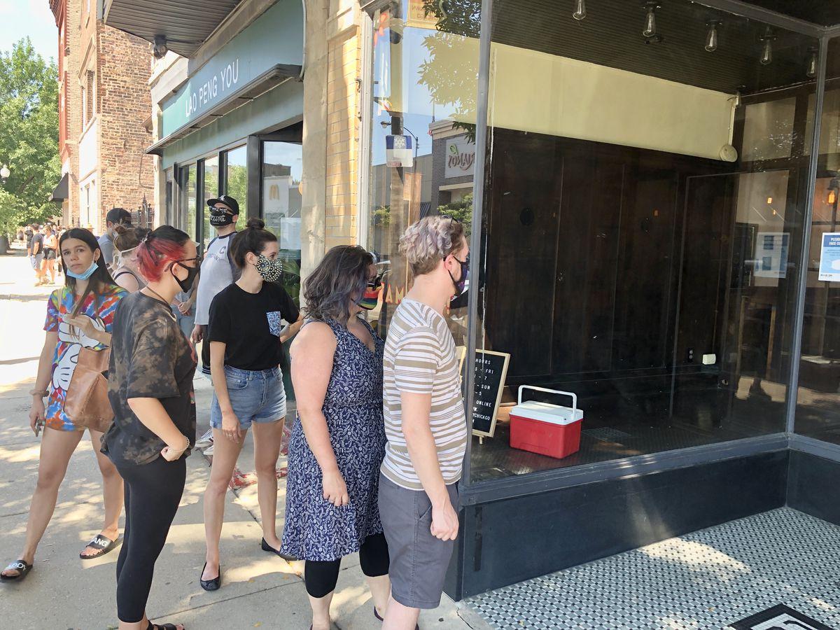 a line outside a restaurant