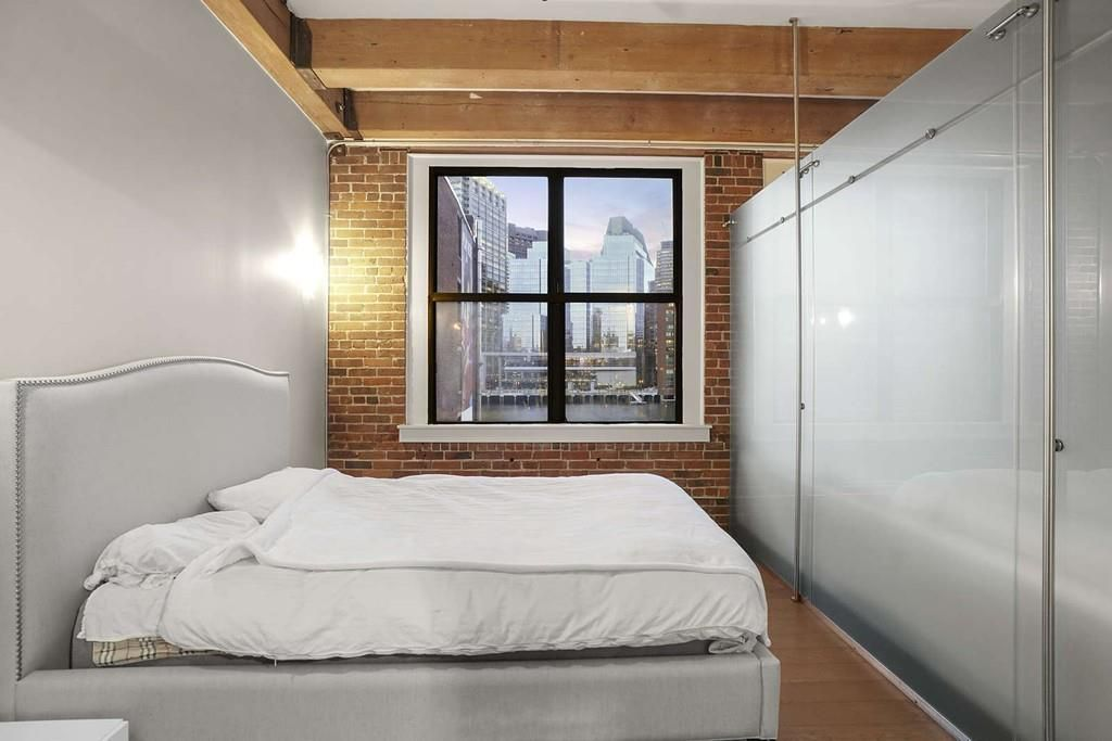 The bed and the window behind the glass.