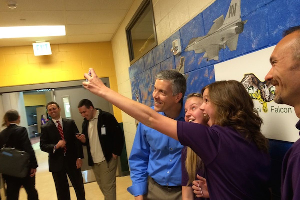 U.S. Secretary of Education Arne Duncan takes a selfie with students from Falcon High School. The students participated in a panel with Duncan on the unique needs of students with family in the military.