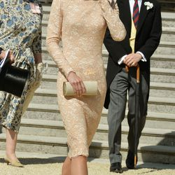 The Duchess attends a garden party at Buckingham Palace on June 10th, 2014 in a lace Alexander McQueen dress.
