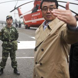In this June 10, 2009 photo, then Chonqing city police chief Wang Lijun, right, talks at a police mission to rescue people after a landslide in Wulong county, in southwestern China's Chongqing city. A Chinese court sentenced the former police who exposed a murder by a Chinese politician's wife to 15 years in prison Monday, Sept. 24, 2012, in a decision that sets the stage for China's leadership to wrap up a seamy political scandal and move ahead with a generational handover of power. (AP Photo) CHINA OUT