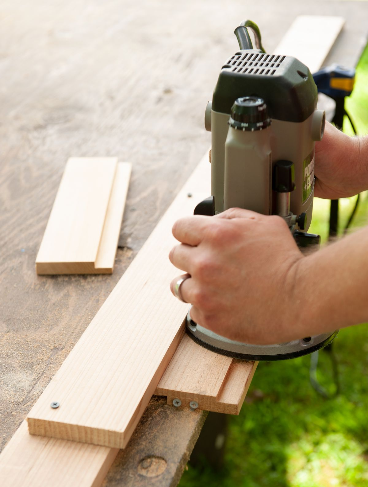 Man Routs Lid Rails And Slats For Cedar Ice Chest Lid