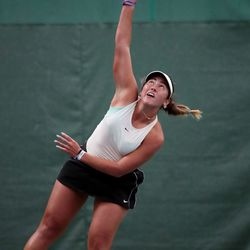 Highland's Dylan Lolofie serves the ball as she battles Sage Bergeson of Woods Cross for the 5A tennis state championship at Salt Lake Tennis & Health Club on Saturday, Oct. 9, 2021.