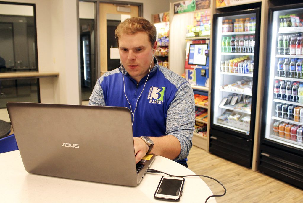 Three Square Market, a software company in River Falls, Wis., is offering to microchip its employees, enabling them to open doors, log onto their computers and buy break room snacks with a simple wave of the hand. | AP Photo