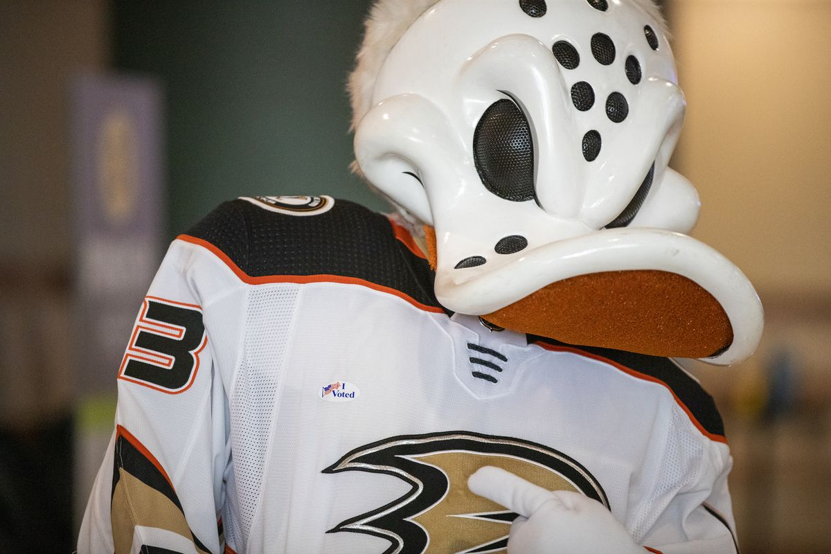 """Ducks mascot Wild Wing shows off his I Voted sticker as he demonstrates how to vote during a media preview Wednesday, September 16, 2020 to showcase how the """"Super Vote Center Site"""" will work at Orange County's Honda Center."""