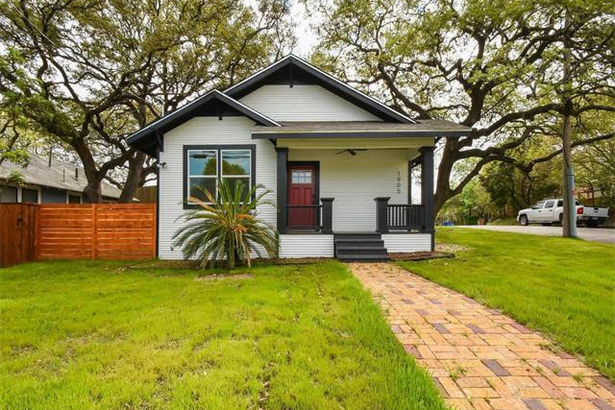 Small white clapboard home with black trim