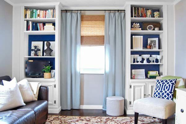 <p>Extending the height and width of the units lends a custom look; painting the exposed back wall dark blue makes the white stand out and the shelves look deeper.</p>