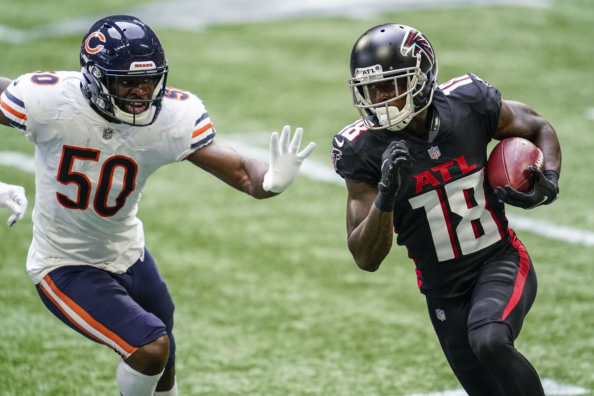 Atlanta Falcons wide receiver Calvin Ridley (18) runs against Chicago Bears linebacker Barkevious Mingo (50) during the first half at Mercedes-Benz Stadium