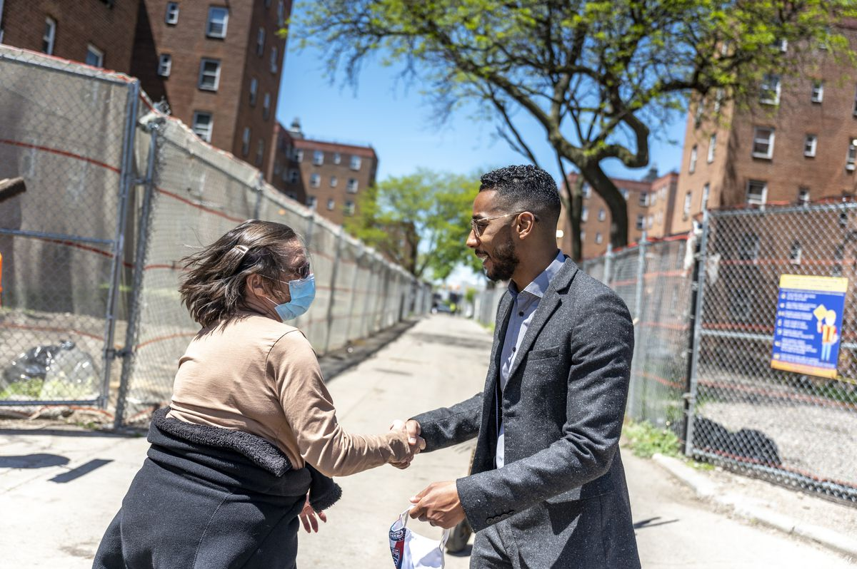 Councilmember Antonio Reynoso greets a constituent at the Red Hook Houses in Brooklyn, May 6, 2021.