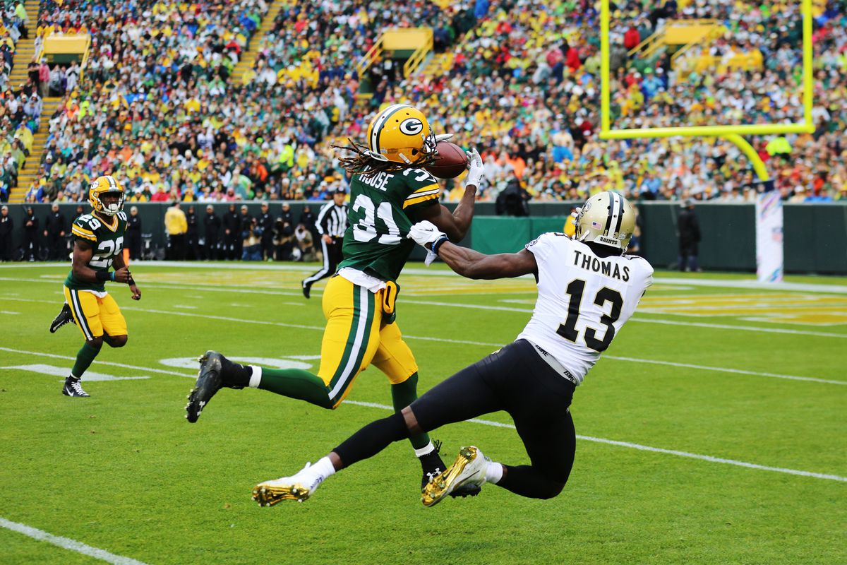 Green Bay Packers cornerback Davon House takes a ball away from New Orleans Saints wide receiver Michael Thomas during a game between the Green Bay Packers and the New Orleans Saints on October 22, 2017 at Lambeau Field in Green Bay, WI.