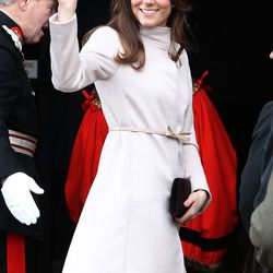 Waving to the crowd on November 28th, 2012 in a Max Mara coat.