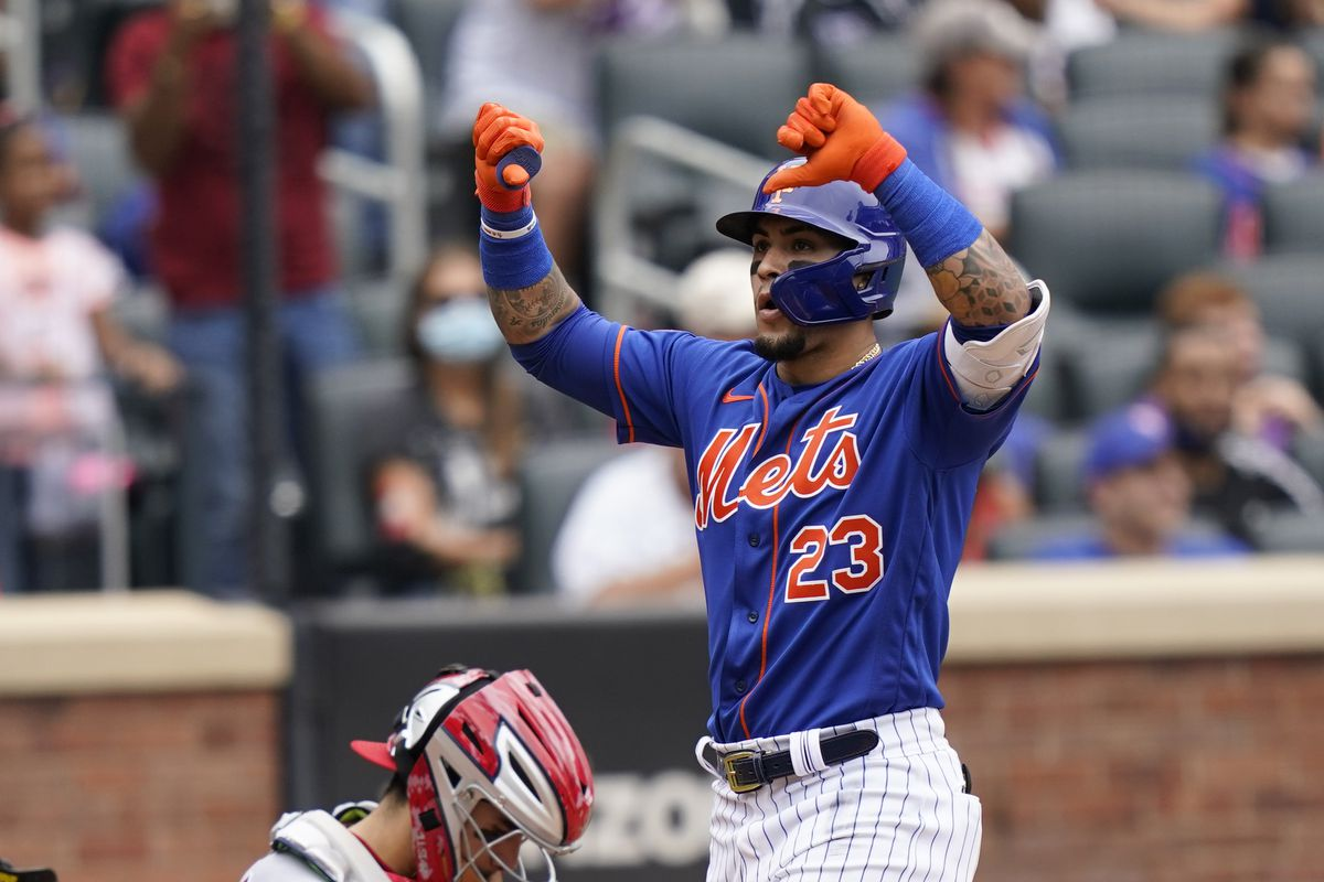 The Mets' Javy Baez gives a thumbs-down gesture at home plate after hitting a two-run home run.