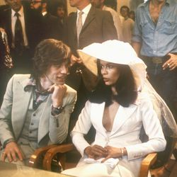 Looking glamorous for her May 12th, 1971 vows to Mick Jagger, Bianca Perez Morera de Macias wore a dramatic hat and tailored skirt set, both by Yves Saint Laurent.