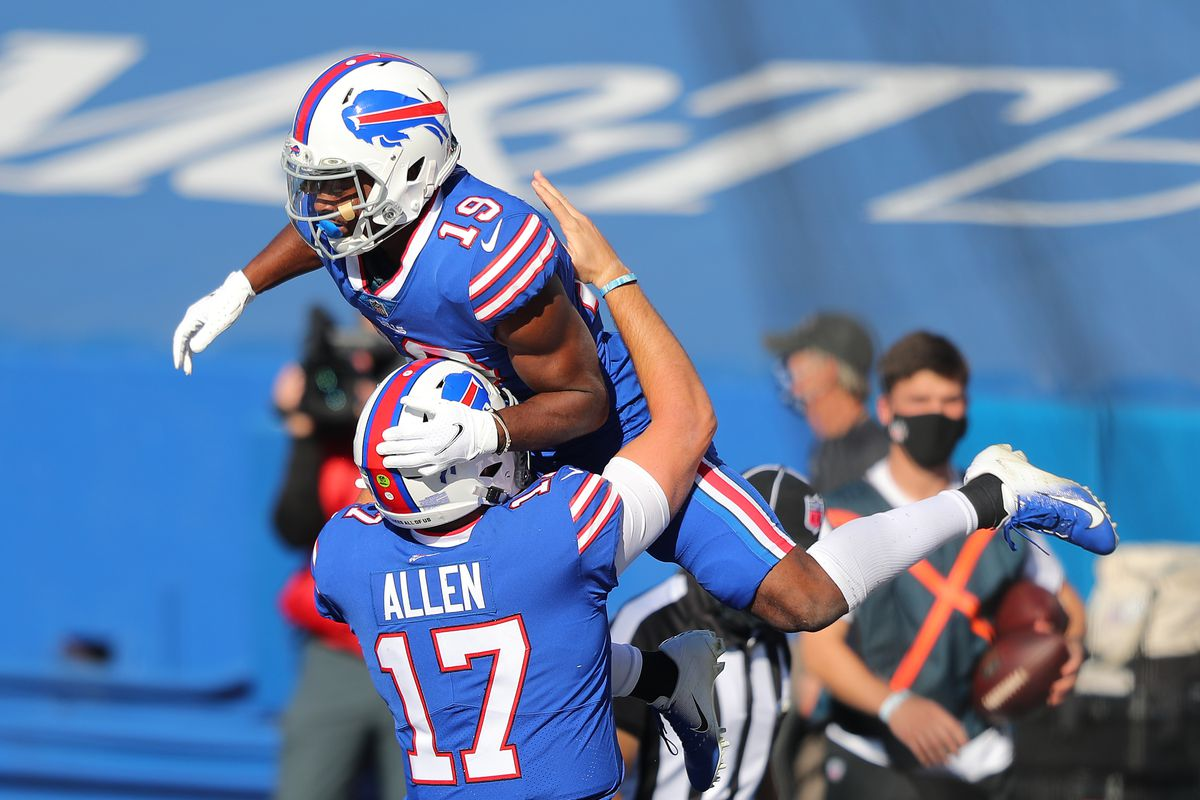 Josh Allen #17 celebrates with Isaiah McKenzie #19 of the Buffalo Bills after McKenzie's touchdown during the first half against the Seattle Seahawks at Bills Stadium on November 08, 2020 in Orchard Park, New York.