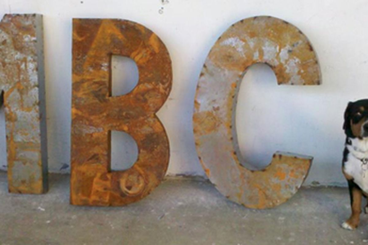 These letters stand for Mission Bowling Club and they're about to be hung on the joint's future patio. That's co-owner Sommer Peterson's pup, Parker.
