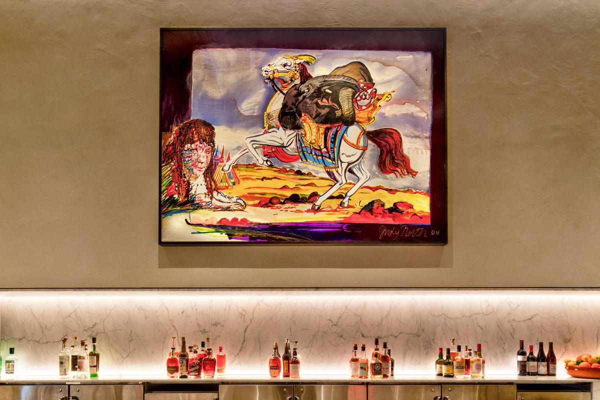 Artwork by Bay Area artist Judy North hangs over the bar