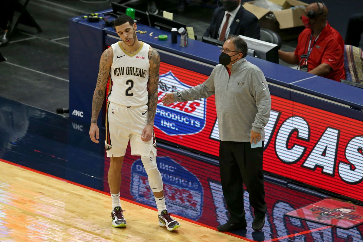 New Orleans Pelicans guard Lonzo Ball talks to head coach Stan Van Gundy in the first quarter of their game against the Milwaukee Bucks at the Smoothie King Center.