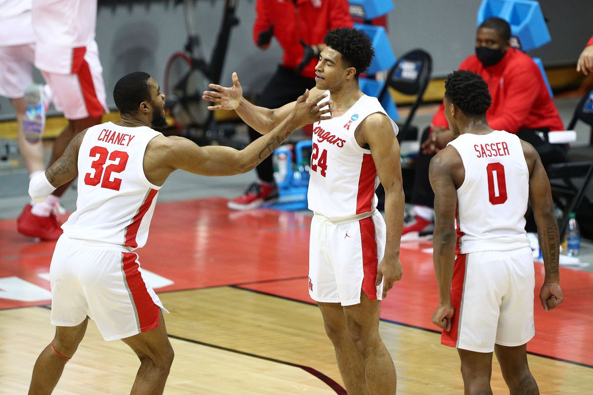 Houston Cougars forward Reggie Chaney guard Quentin Grimes and guard Marcus Sasser celebrate against the Cleveland State Vikings during the second half in the first round of the 2021 NCAA Tournament at Simon Skjodt Assembly Hall.