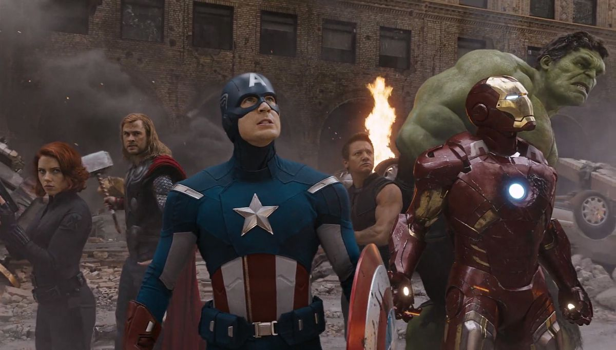The Avengers (2012) - the Avengers looking up from a Manhattan street