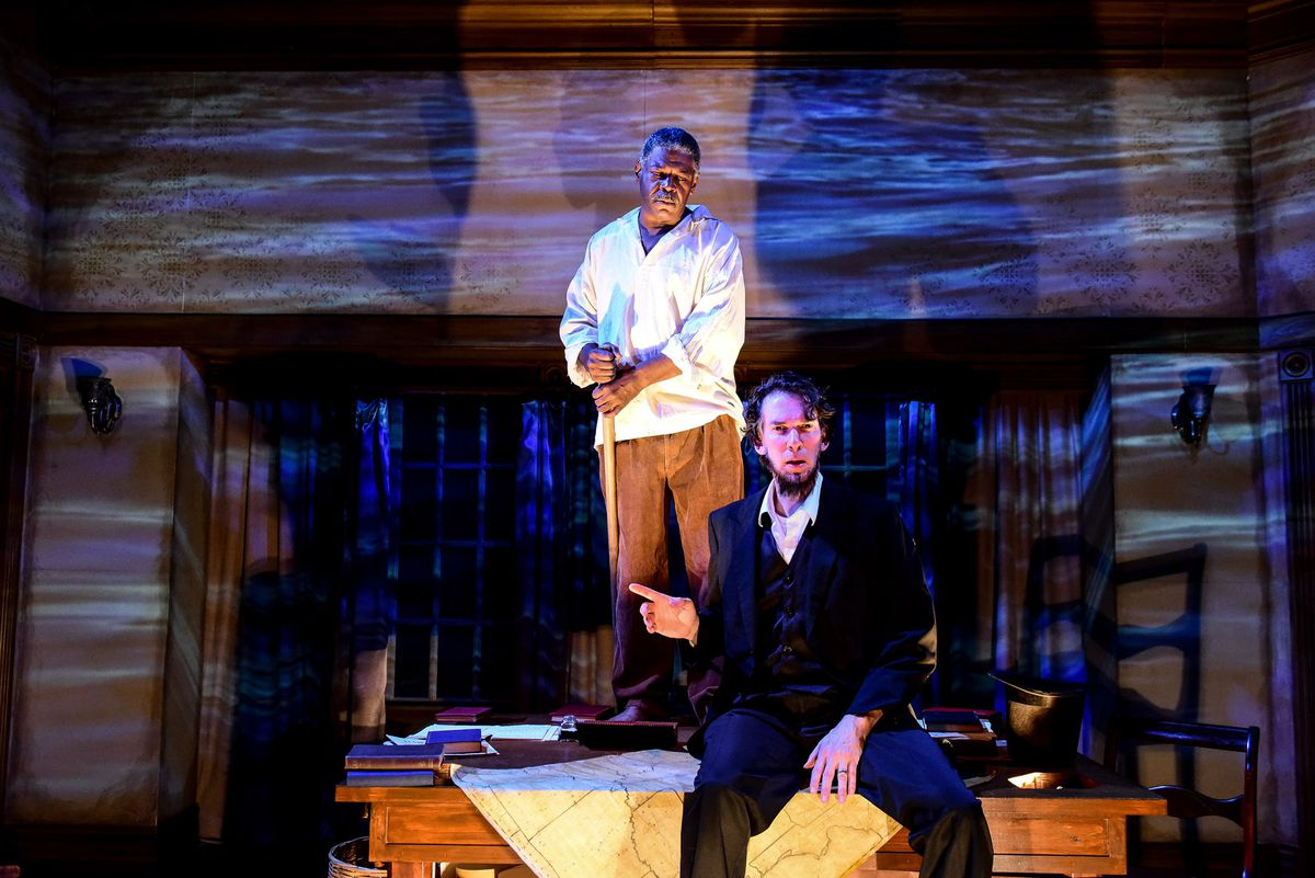 """Lawrence Grimm plays President Abraham Lincoln and Darren Jones is one of the slaves who haunts him in """"The Heavens are Hung in Black.""""   Evan Hanover"""