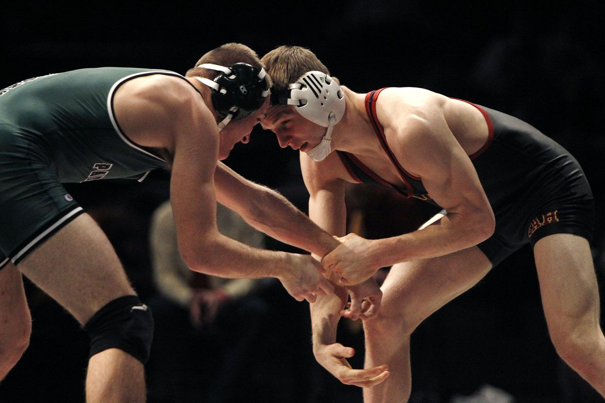 File: Students Preston Stephensen of Wayne and Tyler Bagy of Panguitch compete at the 3A State Wrestling Championships at UVU in Orem Saturday, Feb. 14, 2015.