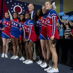 Vice President Joe Biden poses for a photo with the Portsmouth High School Cheerleaders during a campaign event at Portsmouth High School, Sunday, Sept. 9, 2012, in Portsmouth, Ohio.