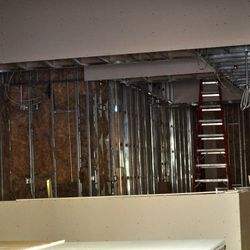 Interior work continues on the walls.