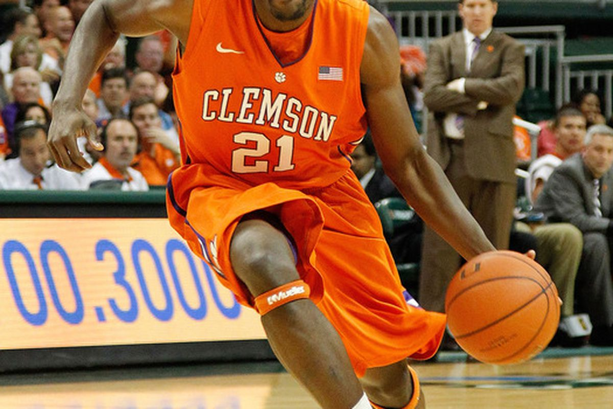 CORAL GABLES, FL - JANUARY 18:  Bryan Narcisse #21 of the Clemson Tigers drives during a game against the Miami (Fl) Hurricanes on January 18, 2012 in Coral Gables, Florida.  (Photo by Mike Ehrmann/Getty Images)