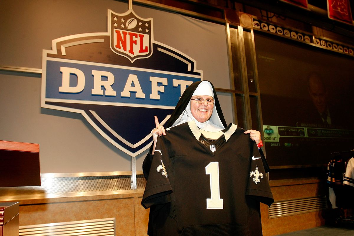 NEW ORLEANS, LA - A fan in a nun's habit holds up a New Orleans Saints jersey at the 2013 NFL Draft display during the Super Bowl XLVII NFL Experience at the Ernest N. Morial Convention Center.