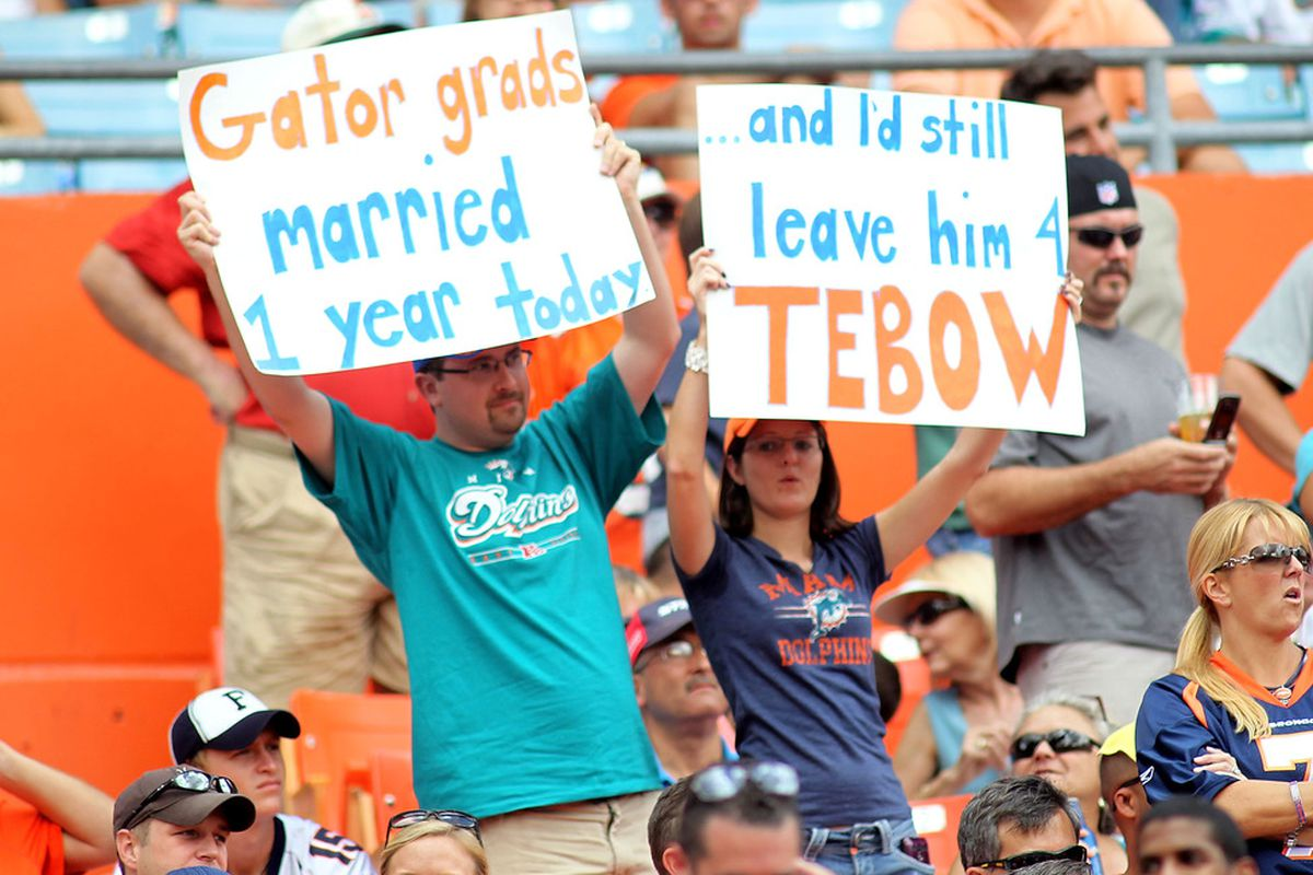 MIAMI GARDENS, FL - OCTOBER 23: Fans of  Quarterback Tim Teebow #15 of the Denver Broncos cheer against the Miami Dolphins at Sun Life Stadium on October 23, 2011 in Miami Gardens, Florida.  (Photo by Marc Serota/Getty Images)