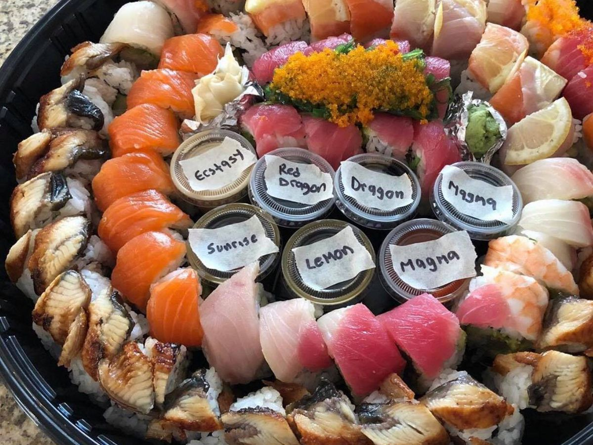A circular platter filled with sushi