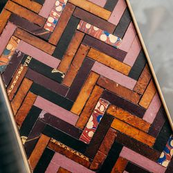<b>Brian Gennett</b> handmade, one-of-a-kind trays featuring geometric patterns made of vintage leather book covers and antique brass, $850