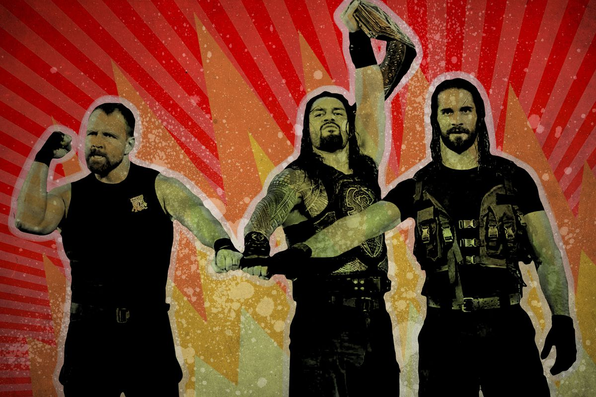 Roman Reigns holding the WWE championship belt with the rest of the Shield