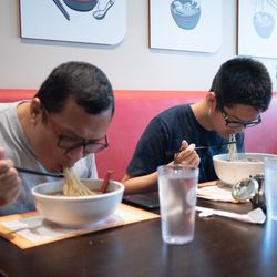 Le and Tao Gaguang of Canada enjoy a lunch in the Slurp Slurp restaurant in the Chinatown neighborhood.   Colin Boyle/Sun-Times