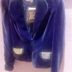 """As one colleague would say, """"Kill it with fire!"""" A velour studded purple blazer at the Juicy store."""