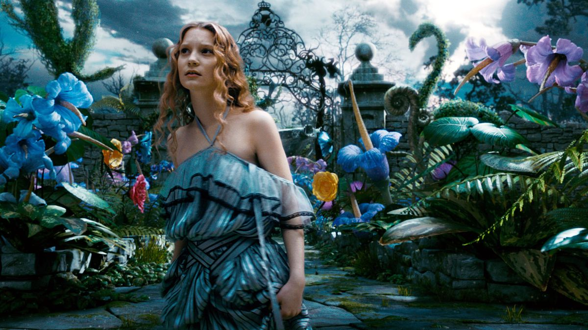 the live action alice looks confused as she wanders through wonderland