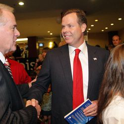 Utah Attorney General John Swallow talks with supporter Verdi Schill at the Hilton in Salt Lake City on Nov. 6, 2012. Swallow is in the spotlight as more call for an investigation into allegations of impropriety.