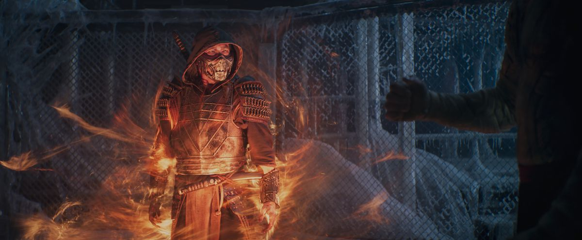 Scorpion stands in flames in an icy retreat in Mortal Kombat 2021
