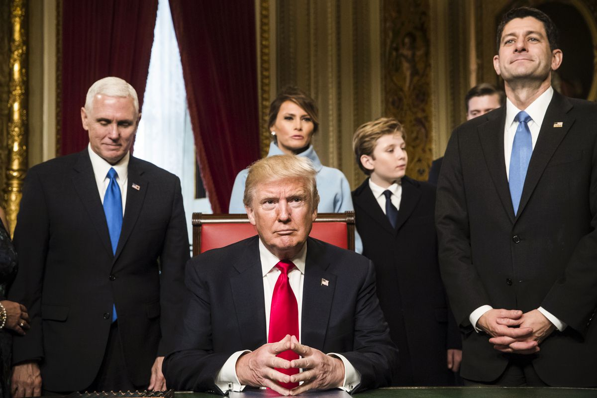 President Trump is joined by the Congressional leadership and his family before formally signing his cabinet nominations into law on January 20, 2017.