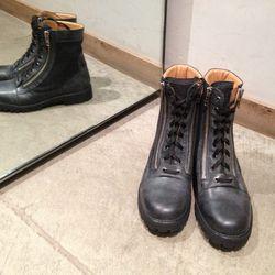 Black double zipper high-top boots by Margiela. Originally $890, now $445