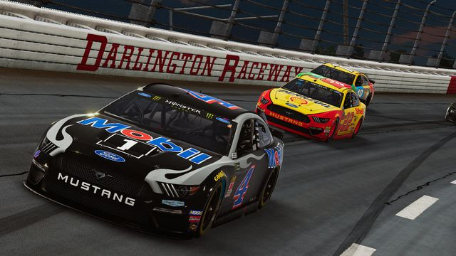 Screenshot of Kevin Harvick and Joey Logano's cars in a turn at Darlington Raceway in NASCAR Heat 4