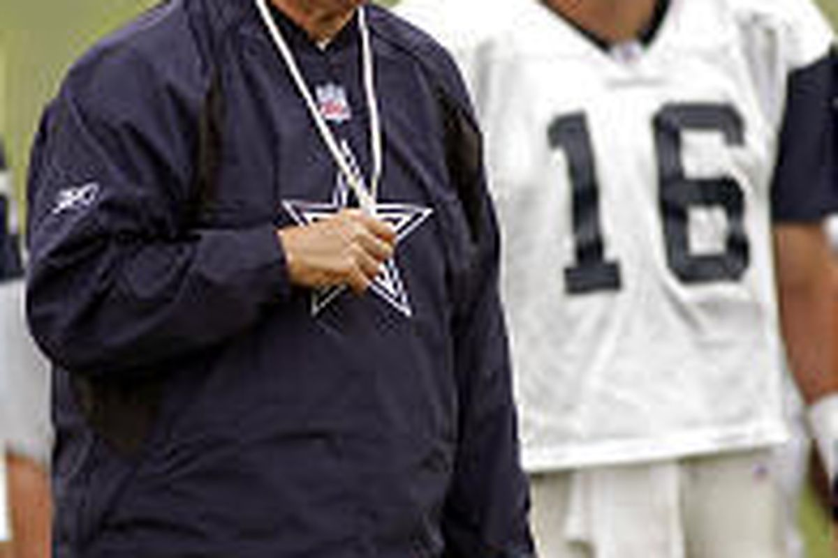 Dallas Cowboys coach Bill Parcells shouts instructions to his team as 40-year-old quarterback Vinny Testaverde looks on at training camp.