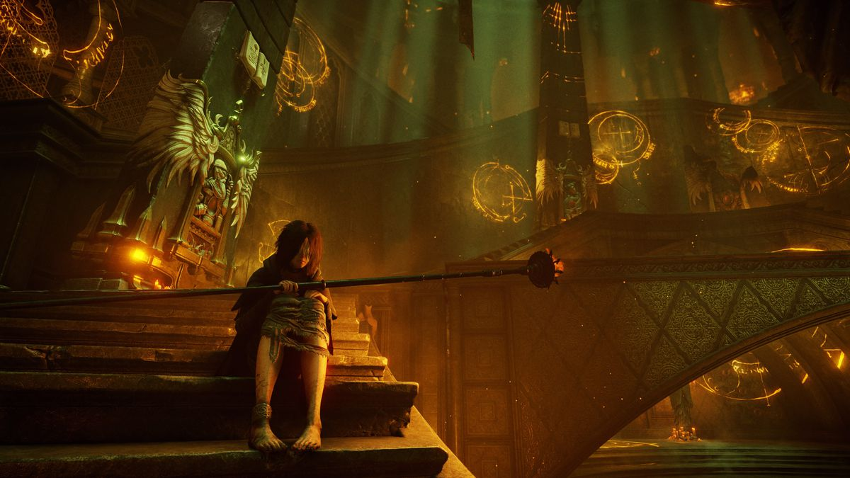 The Maiden in Black sits on stairs in the Nexus in a screenshot from Demon's Souls