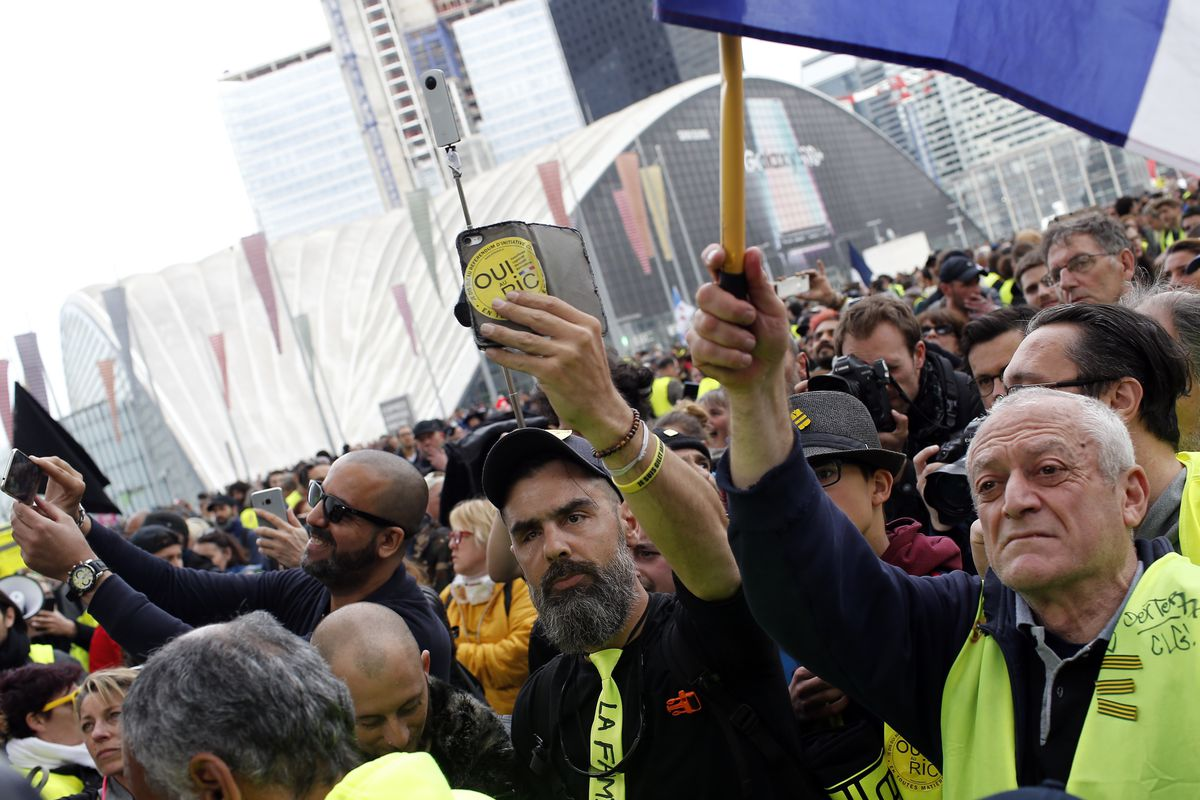 Jerome Rodriguez, center, a prominent figure of the yellow vests movement takes part in a rally in Paris, France, Saturday, April 6, 2019. Protesters from the yellow vest movement are taking to the streets of France for a 21st straight weekend, with hundr