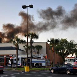 First responders from DeLand Fire Department, Volusia County Fire Services, EVAC and DeLand Police Department work the scene of a small plane crash at the Publix Supermarket on East International Speedway Boulevard, in DeLand, Fla., on Monday April 2, 2012. The small plane sputtered and crashed in flames into the Florida shopping center, injuring at least five people as frightened shoppers rushed from the building, authorities and reports said.