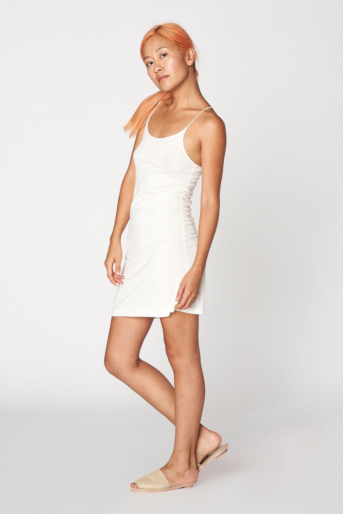 A model in a white cotton dress