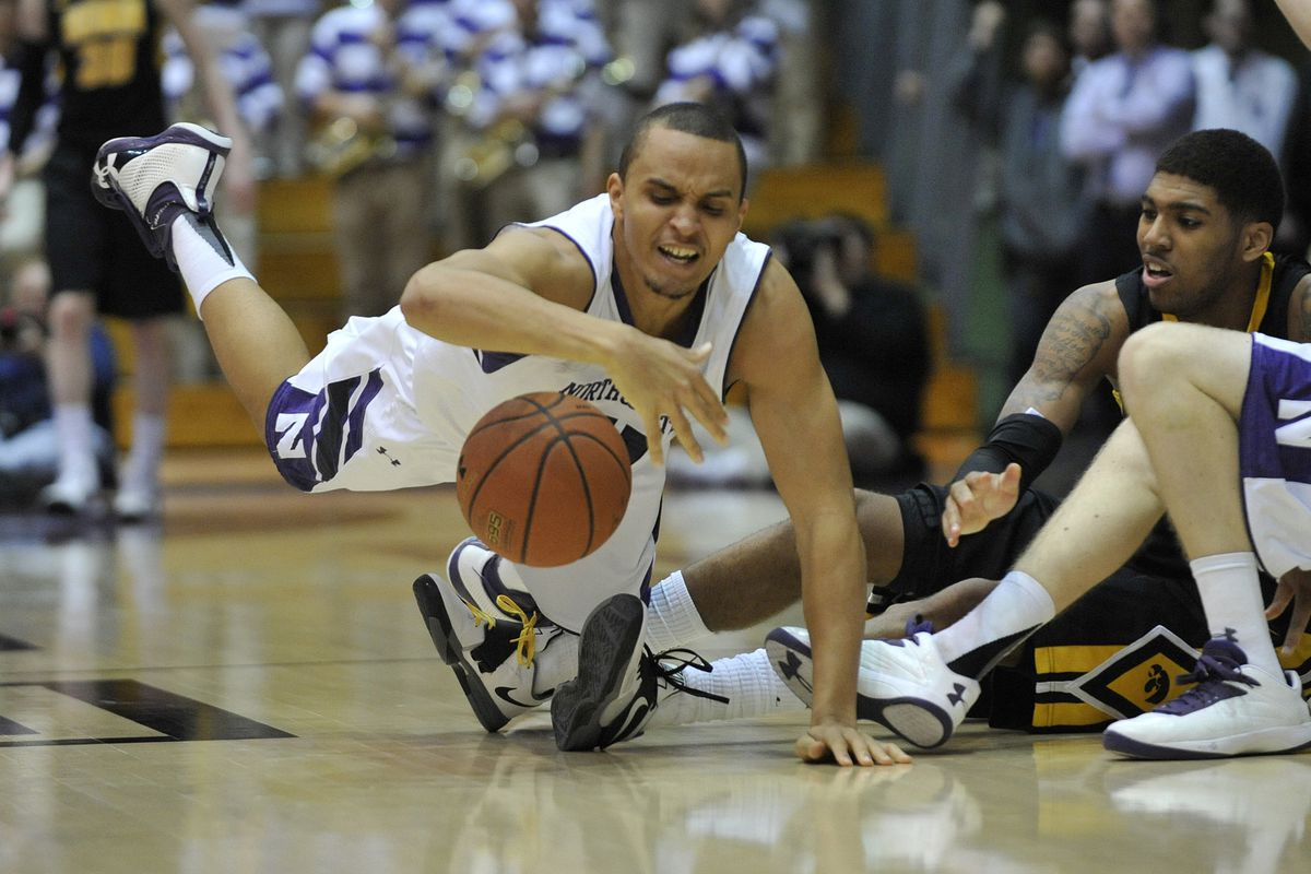 Reggie Hearn, shown diving for a loose ball, is Northwestern's leading scorer at 14.1 points per game. Hearn attended Snider High School in Fort Wayne.