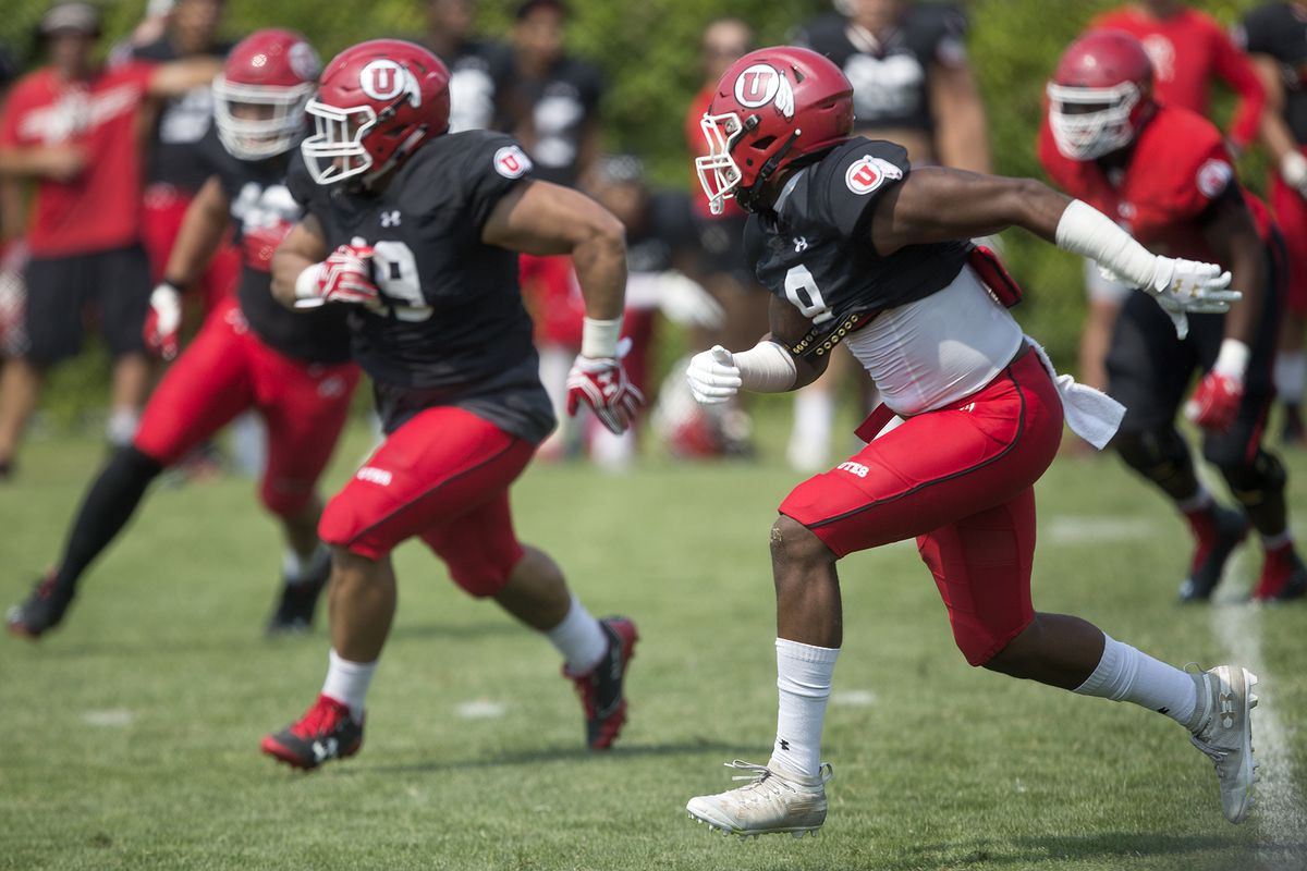 Defensive end Davir Hamilton (9), defensive tackle Pita Tonga (49), and others persue the runner during Utah's football practice in Salt Lake City on Monday, Aug. 6, 2018.